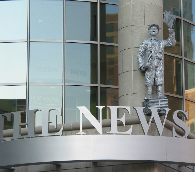 The News Room Paper Boy Statue